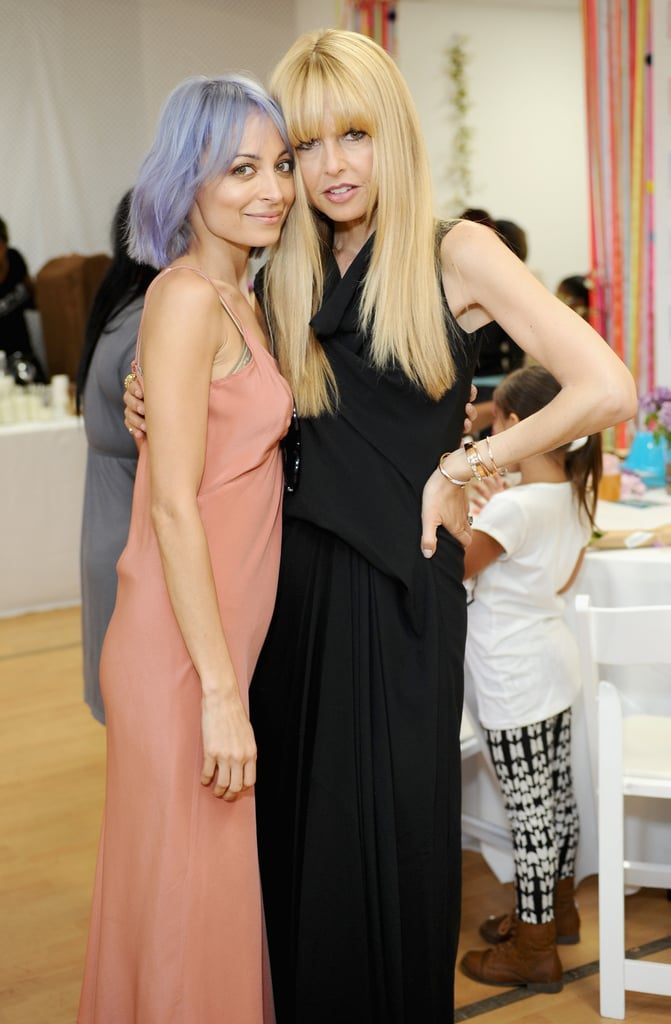 A purple-haired Nicole reunited with Rachel Zoe at the Baby2Baby Mother's Day bash in April 2014.