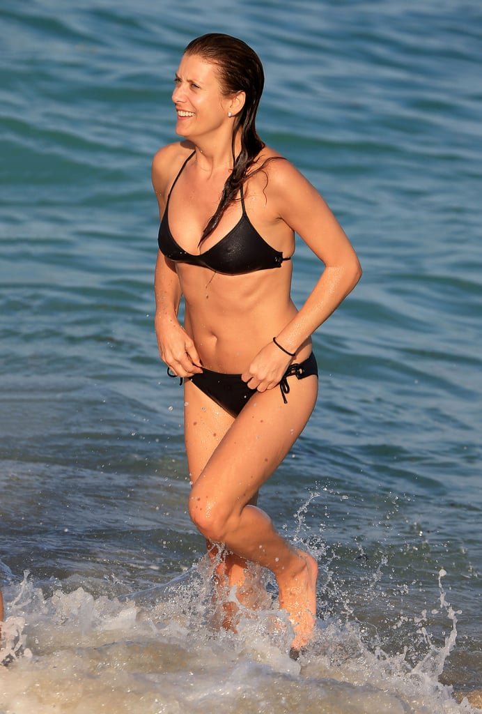 Private Practice star Kate Walsh flaunted her enviable bikini body on Miami Beach on December 13.