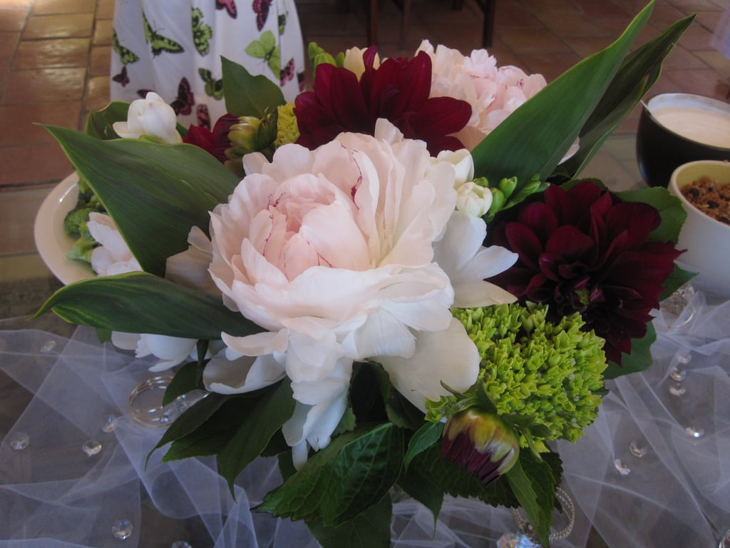 the brides out of town friend sent several large bouquets of beautiful flowers