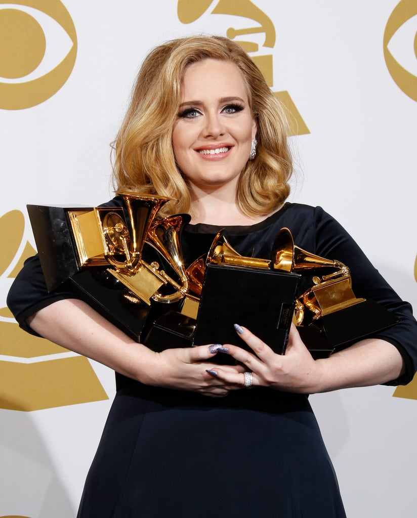 Adele held on to her Grammy Awards in the press room during the 2012 show.