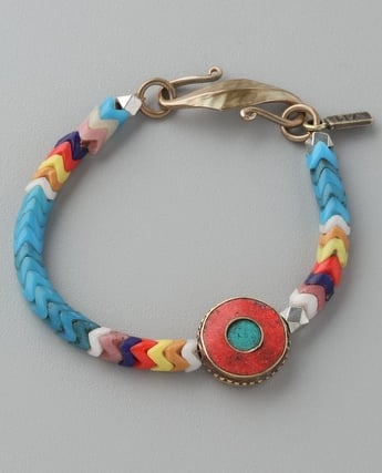 Add this upscale take on the friendship bracelet to a stack of bangles for a pop of color.  Vanessa Mooney African Glass Bracelet ($80)