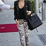 Julianne Hough's Madewell floral skinny jeans ($75, originally $90) got a hint of edge thanks to her black leather biker jacket, black Matt Bernson wedge sandals ($187), and Céline luggage tote.