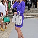 Natalia Vodianova smiled pretty for the camera in a vibrant purple dress and chic pumps.