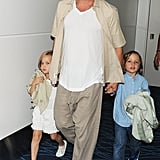 Brad Pitt held on tight to two of his kids, twins Vivienne and Knox, as they walked around Tokyo on July 30.