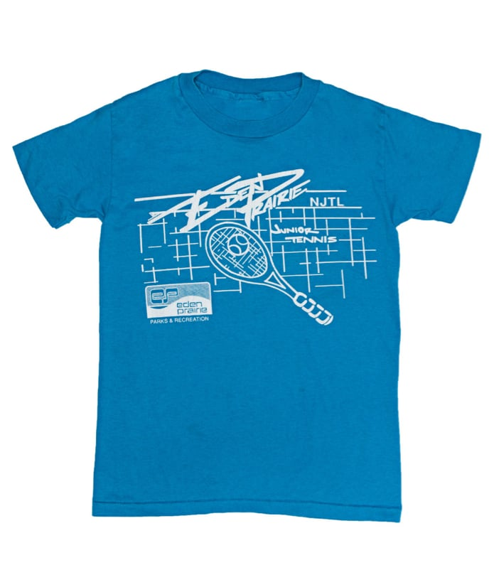 One of the best sources of vintage tees? American Apparel's California Select section and the kids' section at that. Just make sure to purchase the tees in larger sizes and you're good to go.   American Apparel Vintage Kids' Eden Prairie Junior Tennis Threadbare T-Shirt ($16)