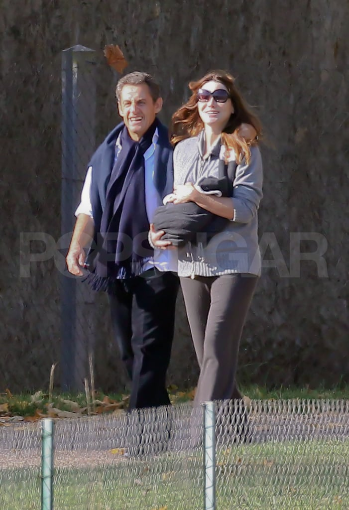 """Carla Bruni's daughter Giulia made her debut this morning while out for a walk with proud dad Nicolas Sarkozy. The happy family went for a stroll and enjoyed the beautiful Fall day on the grounds of the presidential home. Little Giulia is just 12 days old, having entered the world on Oct. 19. To celebrate the arrival of the first baby born to a ruling French couple in office, we took a look back at Carla Bruni and Nicolas Sarkozy's cutest moments.  In the past, Carla has been clear that she'd like to keep her newborn as out of the spotlight as possible. Nonetheless, she announced the little one's name last week and made a quick statement. Carla said, """"I am deeply touched by the many messages of congratulations that I have received since the birth of our daughter Giulia. On this happy occasion, my husband joins me in expressing our warmest thanks to all those of you who sent us these tokens of your kindness."""""""