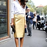 If you are still in a longer hemline from the working day, unbutton your shirt one or two notches for a quick styling hack.
