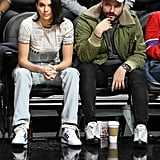 Kendall attended an LA Clippers basketball game in these blue striped Adidas high tops. She hung courtside in a newspaper print tee and baggy jeans.