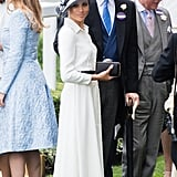 For her first appearance at Royal Ascot, Meghan chose a surprisingly simple Givenchy dress, which she wore with a glamorous Philip Treacy hat and black clutch.
