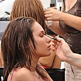 A makeup artist worked on Angelea prior to the shoot.  Photo courtesy of The CW