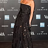 Wearing a Strapless Lace Gown From Her Collection With Casadei Heels