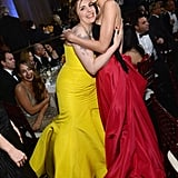 Taylor Swift and Lena Dunham had a girls' moment during the Globes show.