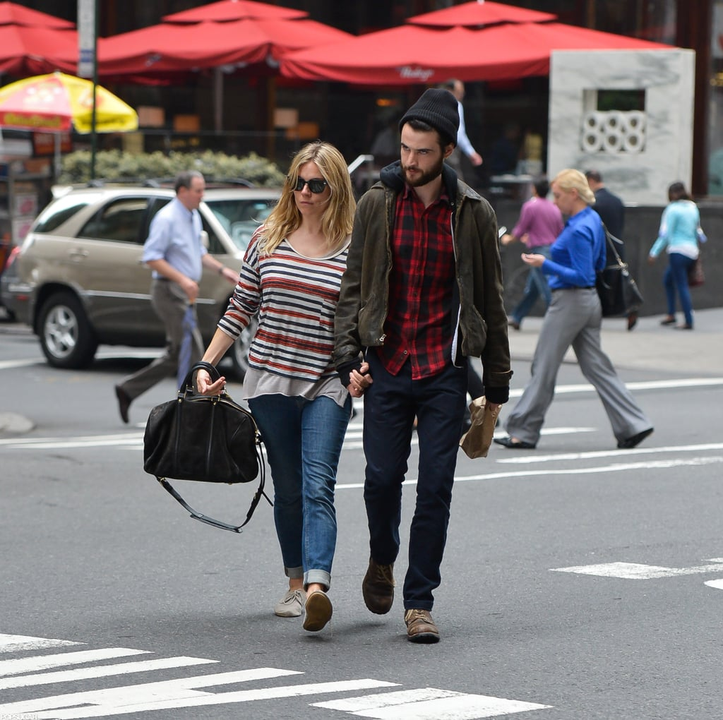 """Sienna Miller and Tom Sturridge were low-key on Friday while out for a walk in NYC. The couple went for a stroll without their baby daughter, Marlowe Sturridge, who entered the world in early July. Sienna, Tom, and Marlowe were in Italy last month for the little one's first-ever holiday. The end of the year will be full of travel for the family, since both Sienna and Tom have movies to promote. His On the Road arrives in US theatres Dec. 21 (it's already out here), while Sienna's The Girl, in which she plays Tippi Hedren opposite Toby Jones as Alfred Hitchcock, airs on HBO Oct. 20. During an interview Sienna granted while in Italy, she spoke about the challenges of playing a real person. She said, """"I went to meet the real Tippi to help understand the role, and found that under the cool Scandinavian exterior she's a warm and maternal figure. . . It was a physically demanding shoot. I was in my first trimester, throwing up a lot. One of the great challenges was maintaining Tippi's stoicism."""""""