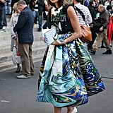 A mix of trends and personal, whimsical style, via statement jewels, a t-shirt, that full skirt, and chic turban.
