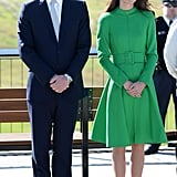 Kate matched the scenery in a bright green coat.