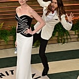 The fun photobombs continued after the Oscars, when Jared Leto snuck up behind Anne Hathaway on his way into the Vanity Fair bash.