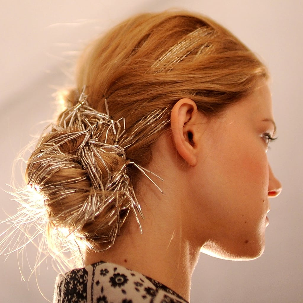 Stylist par excellence Kristin Ess scored some major repins when she put up a photo of this woven bun from the Spring/Summer 2010 Carolina Herrera show.