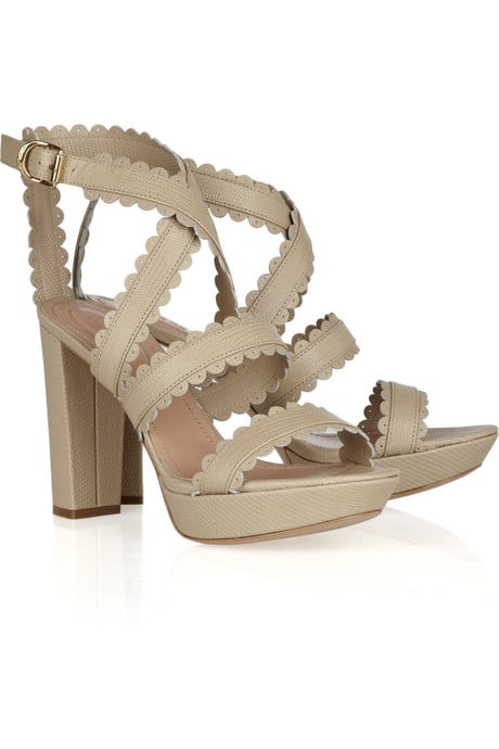 This strappy pair will look just as fantastic with your jeans as they will with your brightly hued cocktail frocks.  See by Chloé Lizard-Effect Leather Sandals ($340)