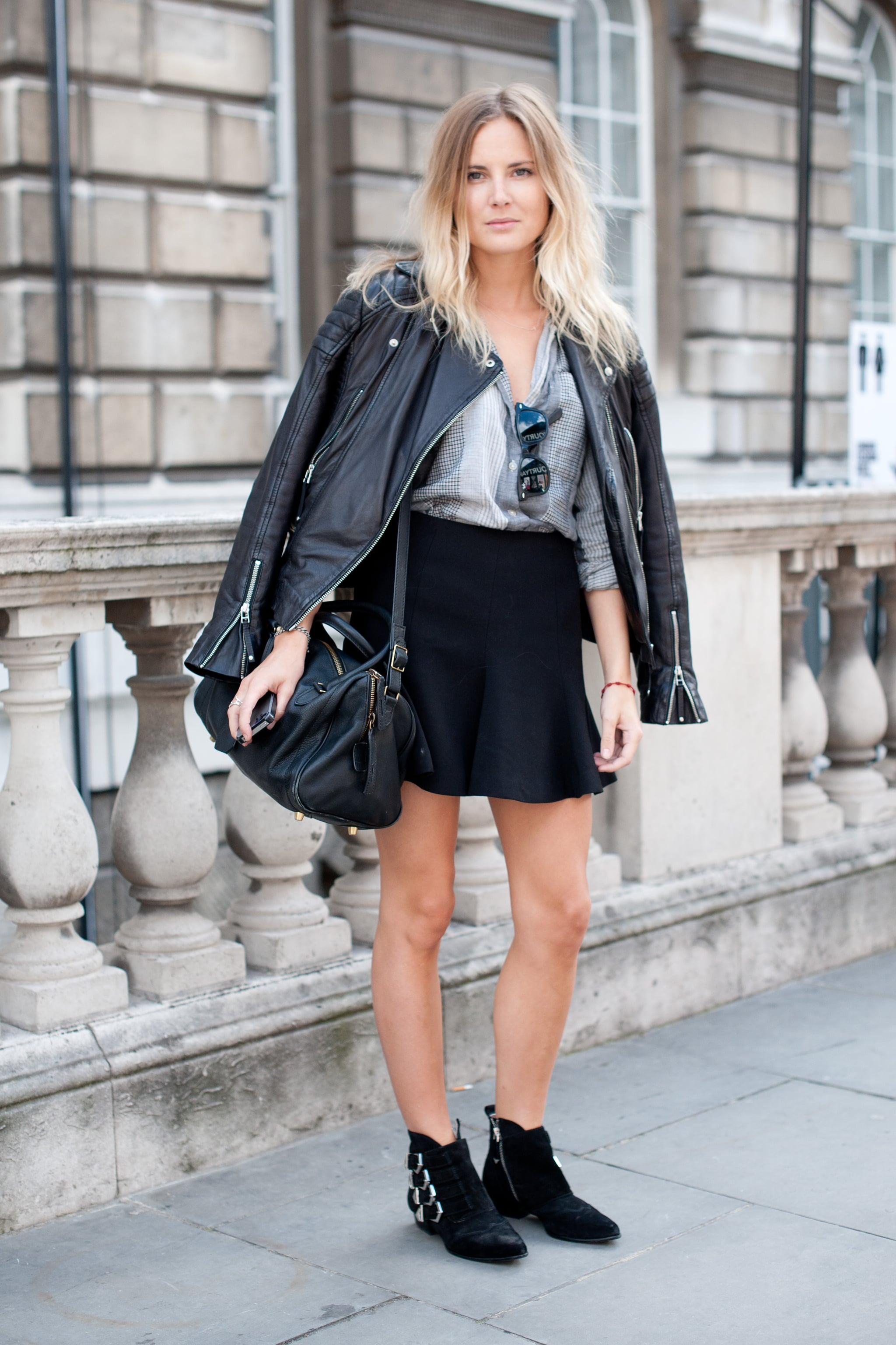We spy a pair of Zara's buckled flat boots on this street styler — and you can follow suit right here.