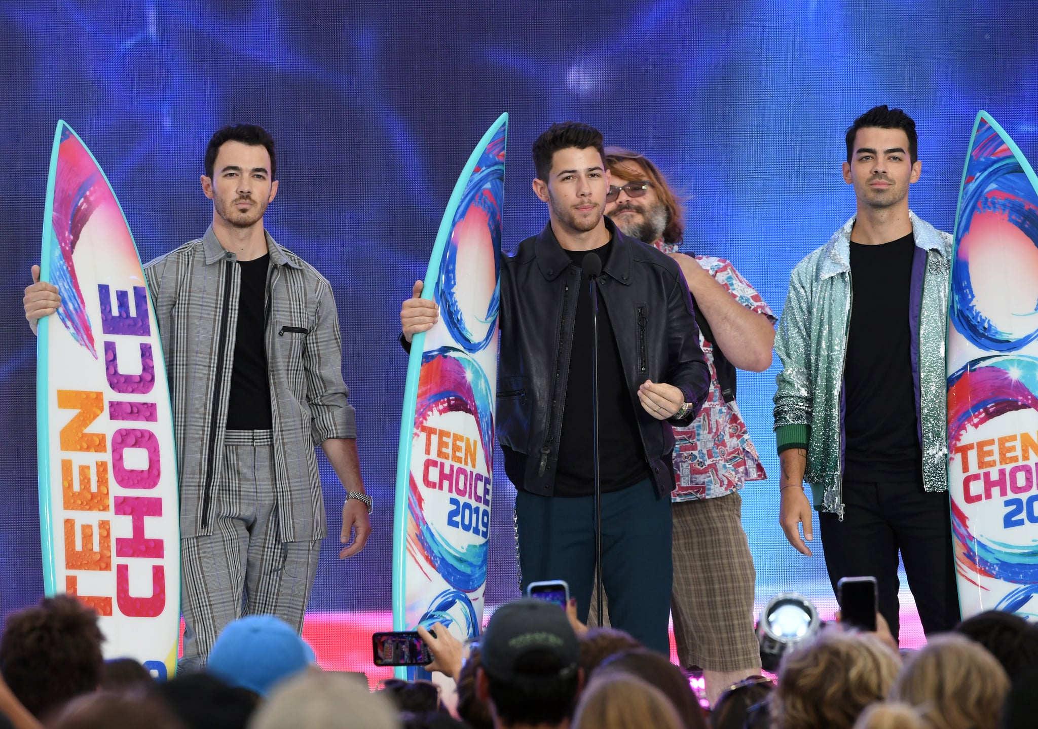 HERMOSA BEACH, CALIFORNIA - AUGUST 11: (L-R) Kevin Jonas, Nick Jonas and Joe Jonas of Jonas Brothers accept the Teen Choice Decade Award onstage during FOX's Teen Choice Awards 2019 on August 11, 2019 in Hermosa Beach, California. (Photo by Kevin Winter/Getty Images)