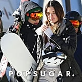 Harry and Kendall carried their snowboards.