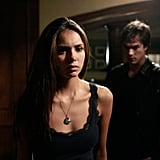Damon still sneaks up behind Elena, but in the first season, it's far less welcome.