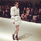 This white fur coat look drew excitement from the crowd. Source: Instagram user popsugarfashion