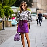 Liven up your Summer workwear attire with a puffy-sleeve top and colorful miniskirt.
