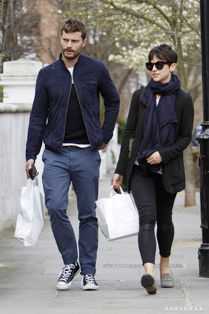 Jamie Dornan and Amelia Warner stepped out on the streets of London on Wednesday, and all we could focus on was how glorious Jamie's scruff looked. Somehow, he was hotter than when we saw him getting ready to play golf a few weeks ago. It's nice to see Jamie squeezing in a little relaxation between Fifty Shades of Grey films, especially since the franchise has faced quite a bit of drama in recent weeks. In addition to the fact that Sam Taylor-Johnson announced her departure from the films, Jamie has had to field rumours about his own departure, his chemistry with costar Dakota Johnson, and his wife's discomfort with his participation in the films. Keep reading to see more pictures from their outing.