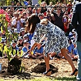 Kate somehow managed to make digging dirt look ladylike while in Australia on April 17.
