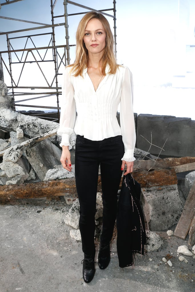 Vanessa Paradis played with separates at the Chanel show, mixing a white blouse with slim black trousers.