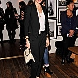 Cameron Diaz looked effortlessly chic in black trousers, a blazer, slouched white tee, and satin pumps.