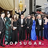 In one of the best photobombs of the night, Benedict Cumberbatch leaped behind U2 on the red carpet.
