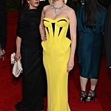 January Jones wore a hot yellow Versace gown.