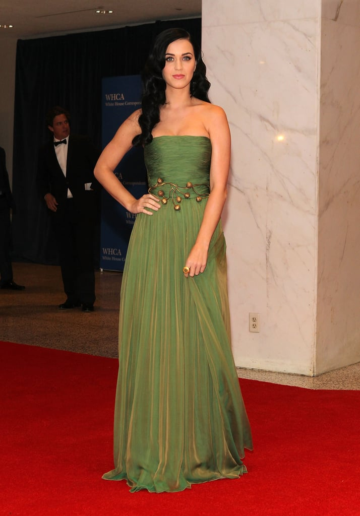 Katy Perry stepped straight out of a fairytale donning a draping moss-green Giambattista Valli gown, cinched with a structured bronze belt, at the White House Correspondents' Association Dinner in April 2013.