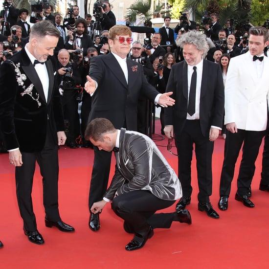 Taron Egerton Tying Elton John's Shoe Cannes Film Festival