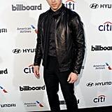 Nick Jonas wore a leather jacket to the 2015 Billboard Power 100 Celebration.