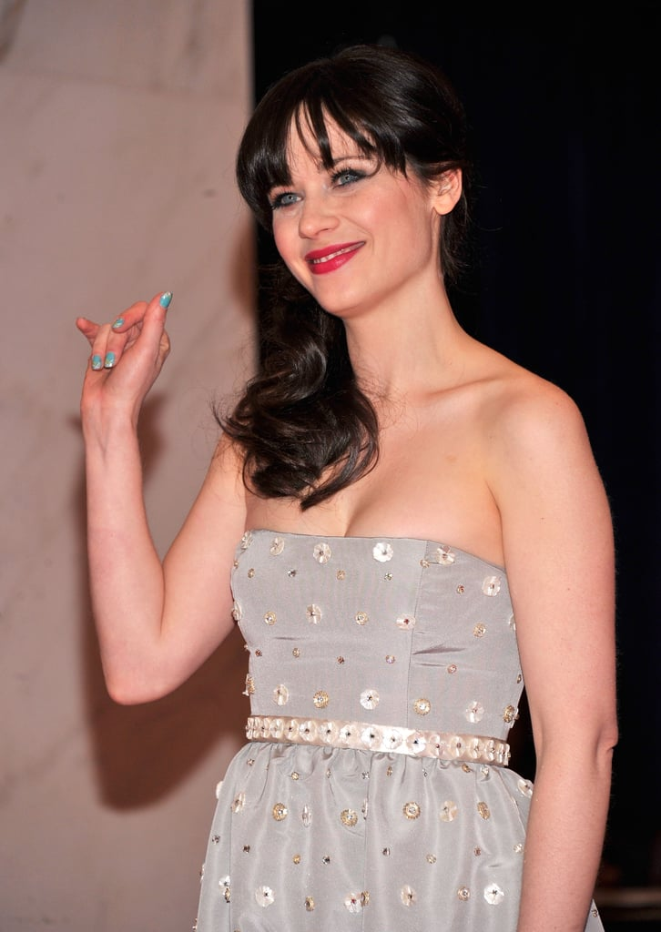 Zooey Deschanel smiled for the camera at the White House Correspondant's Dinner.