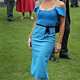 Katherine changed into a blue Roland Mouret dress, Philip Treacy hat, and Jimmy Choos to watch the races.