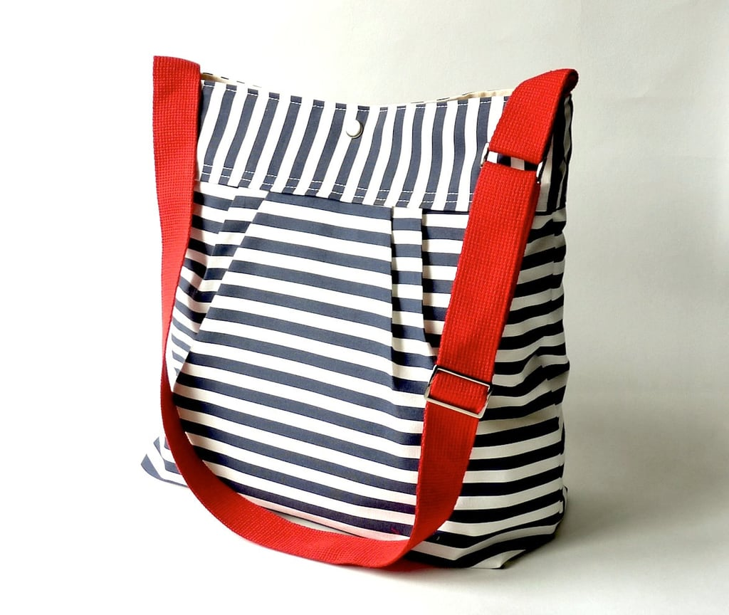 Stockholm Diaper Bag/Messenger Bag in Navy Blue and White Nautical Striped ($79)
