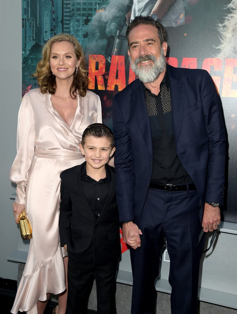 "We love getting little glimpses of Jeffrey Dean Morgan and Hilarie Burton's love. On Wednesday, the couple made their first appearance together since welcoming their daughter George when they attended the premiere of the actor's film Rampage in LA. And that wasn't the only sweet part about their outing! They also brought along their 8-year-old son Augustus for the special occasion. While Jeffrey looked like a doting dad as he held his son's hand on the red carpet, Hilarie wowed in a silk wrap dress. Even Jeffrey couldn't help but gush about her. ""Yeah, she's just a smokin' hot chick!"" he told Entertainment Tonight. Gosh, we love these two. See their latest appearance ahead."