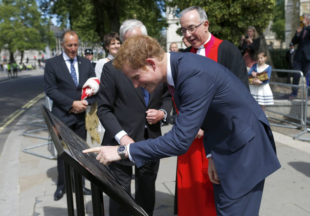 Prince Harry unveiled a royal wedding commemoration plaque in London.