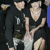 Carey Hart and Pink cuddled up at the Louis Vuitton show in March 2006.