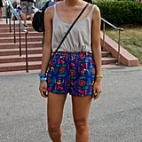 This music fan dressed to have fun, pairing a flouncy tank with playful shorts. Her circle-frame sunglasses and bandana hair tie were perfect accessories.
