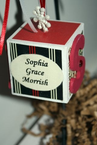Baby First Christmas Wooden Block Ornament ($14)