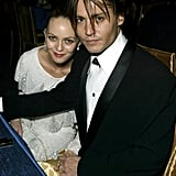 Johnny and Vanessa kept close at an Oscars after party in 2004.
