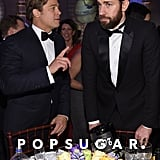 Brad Pitt looked like he was teaching John Krasinski a thing or two.