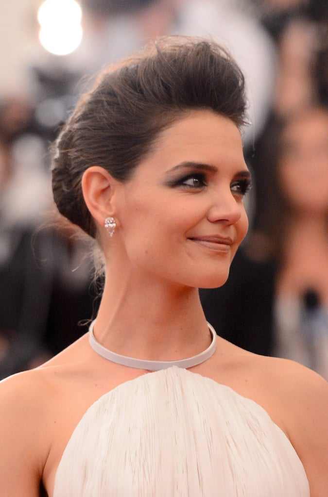 Katie Holmes paired classic pear-shaped diamond studs with her Calvin Klein gown.