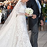 The bride walked down the aisle with her father, Hartmut Lademacher.