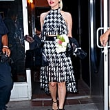 Wearing a houndstooth ensemble with a Delvaux bag.